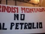Striscione contro petrolio
